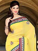 Take the fashion industry by storm in this beautiful embroidered saree. This yellow viscose saree have beautiful embroidery patch work which is embellished with resham, zari, stone and beads work. Fabulous designed embroidery gives you an ethnic look and increasing your beauty. Matching blouse is available. Slight Color variations are possible due to differing screen and photograph resolutions.