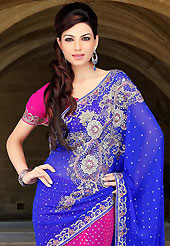 Welcome to the new era of Indian fashion wear. This blue and dark pink faux chiffon lehenga style saree have beautiful embroidery patch work which is embellished with sequins, stone and cutbeads work. Fabulous designed embroidery gives you an ethnic look and increasing your beauty. Matching dark pink blouse is available. Slight Color variations are possible due to differing screen and photograph resolutions.