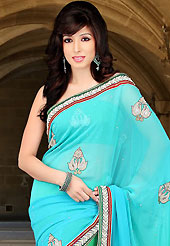 Envelope yourself in classic look with this charming saree. This shaded light blue and green viscose saree have beautiful embroidery patch work which is embellished with sequins, stone, zardosi and beads work. Fabulous designed embroidery gives you an ethnic look and increasing your beauty. Matching blouse is available. Slight Color variations are possible due to differing screen and photograph resolutions.
