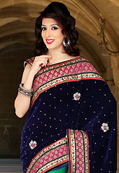 Keep the interest with this designer embroidery saree. This navy blue and green velvet and net saree have beautiful embroidery patch work which is embellished with resham, stone and cutbeads work. Fabulous designed embroidery gives you an ethnic look and increasing your beauty. Matching blouse is available. Slight Color variations are possible due to differing screen and photograph resolutions.