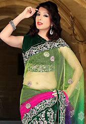 Welcome to the new era of Indian fashion wear. This shaded green, pink and purple net and velvet lehenga style saree have beautiful embroidery patch work which is embellished with zari, stone, applique, cutdana and cutbeads work. Fabulous designed embroidery gives you an ethnic look and increasing your beauty. Matching dark green velvet blouse is available. Slight Color variations are possible due to differing screen and photograph resolutions.