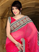 Elegance and innovation of designs crafted for you. This shaded deep pink viscose saree have beautiful embroidery patch work which is embellished with sequins, stone, cutdana, kasab and cutbeads work. Fabulous designed embroidery gives you an ethnic look and increasing your beauty. Matching blouse is available. Slight Color variations are possible due to differing screen and photograph resolutions.