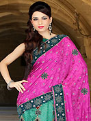 Envelope yourself in classic look with this charming saree. This magenta and turquoise green art silk and net lehenga style saree have beautiful embroidery patch work which is embellished with zari, sequins, stone, cutdana and cutbeads work. Fabulous designed embroidery gives you an ethnic look and increasing your beauty. Matching blouse is available. Slight Color variations are possible due to differing screen and photograph resolutions.