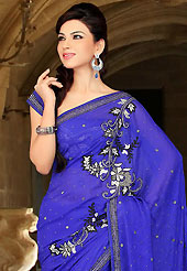 An endearing splash oh colors look gorgeous tridimensional charm. This royal blue satin chiffon saree have beautiful embroidery patch work which is embellished with reham, sequins, stone and cutbeads work. Fabulous designed embroidery gives you an ethnic look and increasing your beauty. Matching blouse is available. Slight Color variations are possible due to differing screen and photograph resolutions.