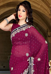 The evolution of style species collection spells pure femininity. This burgundy faux georgette saree have beautiful embroidery patch work which is embellished with sequins, stone, cutdana and cutbeads work. Fabulous designed embroidery gives you an ethnic look and increasing your beauty. Matching blouse is available. Slight Color variations are possible due to differing screen and photograph resolutions.