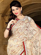 This season dazzle and shine in pure colors. This cream net saree have beautiful embroidery patch work which is embellished with sequins, stone, cutdana and cutbeads work. Fabulous designed embroidery gives you an ethnic look and increasing your beauty. Contrasting red blouse is available. Slight Color variations are possible due to differing screen and photograph resolutions.