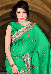 Emblem of fashion and beauty, each piece of our range of embroidered saree is certain to enhance your look as per today's trends. This green art silk saree have beautiful embroidery patch work which is embellished with zari, sequins and stone work. Fabulous designed embroidery gives you an ethnic look and increasing your beauty. Matching blouse is available. Slight Color variations are possible due to differing screen and photograph resolutions.