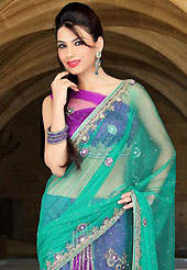 Attract all attentions with this embroidered saree. This green and purple net lehenga style saree have beautiful embroidery patch work which is embellished with zari, sequins, stone and cutbeads work. Fabulous designed embroidery gives you an ethnic look and increasing your beauty. Matching blouse is available. Slight Color variations are possible due to differing screen and photograph resolutions.