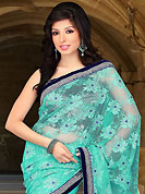 Ultimate collection of embroidered sarees with fabulous style. This sea green net saree have beautiful embroidery patch work which is embellished with silver zari, sequins and stone work. Fabulous designed embroidery gives you an ethnic look and increasing your beauty. Contrasting dark navy blue blouse is available. Slight Color variations are possible due to differing screen and photograph resolutions.