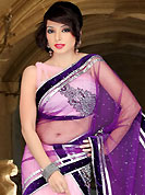 Take the fashion industry by storm in this beautiful embroidered saree. This pink and dark purple net lehenga style saree have beautiful embroidery and velvet patch work which is embellished with zari, stone, cutdana and cutbeads work. Fabulous designed embroidery gives you an ethnic look and increasing your beauty. Matching blouse is available. Slight Color variations are possible due to differing screen and photograph resolutions.