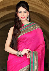 Try out this year top trend, glowing, bold and natural collection. This hot pink art silk saree have beautiful embroidery patch work which is embellished with zari and stone work. Fabulous designed embroidery gives you an ethnic look and increasing your beauty. Matching blouse is available. Slight Color variations are possible due to differing screen and photograph resolutions.