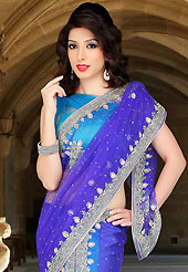 Keep the interest with this designer embroidery saree. This dark blue and light blue net lehenga style saree have beautiful embroidery patch work which is embellished with sequins, stone, cutdana and cutbeads work. Fabulous designed embroidery gives you an ethnic look and increasing your beauty. Matching blouse is available. Slight Color variations are possible due to differing screen and photograph resolutions.