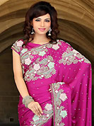 Make a trendy look with this classic embroidered saree. This dark pink satin chiffon saree have beautiful embroidery patch work which is embellished with resham, zari, stone, cutdana and cutbeads work. Fabulous designed embroidery gives you an ethnic look and increasing your beauty. Matching blouse is available. Slight Color variations are possible due to differing screen and photograph resolutions.