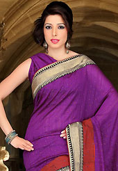 Welcome to the new era of Indian fashion wear. This purple art silk saree have beautiful embroidery patch work which is embellished with thread, zari and stone work. Fabulous designed embroidery gives you an ethnic look and increasing your beauty. Matching blouse is available. Slight Color variations are possible due to differing screen and photograph resolutions.