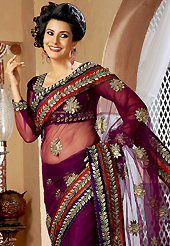 The traditional patterns used on this saree maintain the ethnic look. This burgundy net saree is nicely designed with embroidery and velvet patch work is done with resham, zari and stone work. Beautiful embroidery work on saree make attractive to impress all. This saree gives you a modern and different look in fabulous style. Matching blouse is available. Slight color variations are possible due to differing screen and photograph resolution.