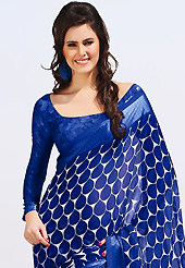 Keep the interest with this printed saree. This beautiful blue and off white faux chiffon saree is nicely designed with abstract, floral print work. Beautiful print work on saree make attractive to impress all. It will enhance your personality and gives you a singular look. Matching blouse is available with this saree. Slight color variations are due to differing screen and photography resolution.