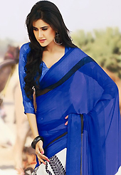 It is color this season and bright shaded suits are really something that is totally in vogue. This beautiful blue and white faux chiffon saree is nicely designed with paisley print work. Beautiful print work on saree make attractive to impress all. It will enhance your personality and gives you a singular look. Matching blouse is available with this saree. Slight color variations are due to differing screen and photography resolution.