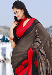 Era with extension in fashion, style, Grace and elegance have developed grand love affair with this ethnical wear. This beautiful light brown, red and black brasso faux georgette saree is nicely designed with geometric print work. Beautiful print work on saree make attractive to impress all. It will enhance your personality and gives you a singular look. Matching blouse is available with this saree. Slight color variations are due to differing screen and photography resolution.