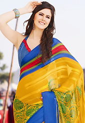 Get ready to sizzle all around you by sparkling saree. This beautiful yellow, blue and red brasso faux georgette saree is nicely designed with floral and abstract print work. Beautiful print work on saree make attractive to impress all. It will enhance your personality and gives you a singular look. Matching blouse is available with this saree. Slight color variations are due to differing screen and photography resolution.