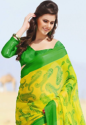 Ultimate collection of embroidered sarees with fabulous style. This beautiful yellow and green faux chiffon saree is nicely designed with paisley and abstract print work. Beautiful print work on saree make attractive to impress all. It will enhance your personality and gives you a singular look. Matching blouse is available with this saree. Slight color variations are due to differing screen and photography resolution.