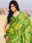 Printed sarees are the best choice for a girl to enhance her feminine look. This beautiful green and yellow brasso faux georgette saree is nicely designed with abstract and stripe print work. Beautiful print work on saree make attractive to impress all. It will enhance your personality and gives you a singular look. Matching blouse is available with this saree. Slight color variations are due to differing screen and photography resolution.