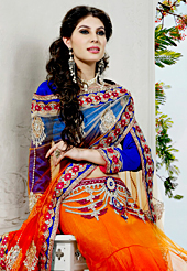 Look stunning rich with dark shades and floral patterns. This dark orange net saree have beautiful embroidery patch work which is embellished with resham, zari, stone, cutdana, beads and lace work. Fabulous designed embroidery gives you an ethnic look and increasing your beauty. Contrasting royal blue blouse is available. Slight Color variations are possible due to differing screen and photograph resolutions.