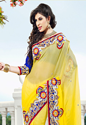 Emblem of fashion and beauty, each piece of our range of embroidered saree is certain to enhance your look as per today's trends. This yellow viscose georgette saree have beautiful embroidery patch work which is embellished with resham, zari, stone and beads work. Fabulous designed embroidery gives you an ethnic look and increasing your beauty. Contrasting royal blue blouse is available. Slight Color variations are possible due to differing screen and photograph resolutions.