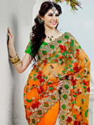 Envelope yourself in classic look with this charming saree. This shaded orange net saree have beautiful embroidery patch work which is embellished with resham and stone work. Fabulous designed embroidery gives you an ethnic look and increasing your beauty. Contrasting green blouse is available. Slight Color variations are possible due to differing screen and photograph resolutions.