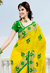 Welcome to the new era of Indian fashion wear. This yellow viscose georgette saree have beautiful embroidery patch work which is embellished with resham, stone and beads work. Fabulous designed embroidery gives you an ethnic look and increasing your beauty. Contrasting green blouse is available. Slight Color variations are possible due to differing screen and photograph resolutions.