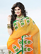 Ultimate collection of embroidered sarees with fabulous style. This yellow and shaded orange viscose georgette saree have beautiful embroidery patch work which is embellished with resham, stone and beads work. Fabulous designed embroidery gives you an ethnic look and increasing your beauty. Contrasting green blouse is available. Slight Color variations are possible due to differing screen and photograph resolutions.