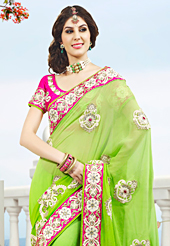 Try out this year top trend, glowing, bold and natural collection. This light green viscose georgette saree have beautiful embroidery patch work which is embellished with resham, stone and beads work. Fabulous designed embroidery gives you an ethnic look and increasing your beauty. Contrasting pink blouse is available. Slight Color variations are possible due to differing screen and photograph resolutions.