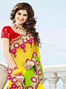Keep the interest with this designer embroidery saree. This shaded yellow and light green viscose georgette saree have beautiful embroidery patch work which is embellished with resham, stone and beads work. Fabulous designed embroidery gives you an ethnic look and increasing your beauty. Contrasting red blouse is available. Slight Color variations are possible due to differing screen and photograph resolutions.