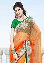 The traditional patterns used on this saree maintain the ethnic look. This shaded orange net saree have beautiful embroidery patch work which is embellished with resham, zardosi, stone and beads work. Fabulous designed embroidery gives you an ethnic look and increasing your beauty. Contrasting green blouse is available. Slight Color variations are possible due to differing screen and photograph resolutions.