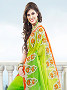 Embroidered sarees are the best choice for a girl to enhance her feminine look. This shaded light green viscose georgette saree have beautiful embroidery patch work which is embellished with resham, stone and beads work. Fabulous designed embroidery gives you an ethnic look and increasing your beauty. Contrasting orange blouse is available. Slight Color variations are possible due to differing screen and photograph resolutions.