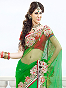 Envelope yourself in classic look with this charming saree. This green net saree have beautiful embroidery patch work which is embellished with resham, stone and beads work. Fabulous designed embroidery gives you an ethnic look and increasing your beauty. Contrasting dark red blouse is available. Slight Color variations are possible due to differing screen and photograph resolutions.