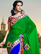 Ultimate collection of embroidery sarees with fabulous style. This green and royal blue georgette saree have beautiful embroidery patch work which is embellished with resham, beads and lace work. Fabulous designed embroidery gives you an ethnic look and increasing your beauty. Matching blouse is available. Slight Color variations are possible due to differing screen and photograph resolutions.
