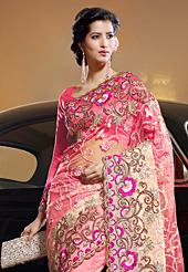 It is color this season and bright shaded suits are really something that is totally in vogue. This shaded pink and cream net saree have beautiful embroidery patch work which is embellished with resham, zari and stone work. Fabulous designed embroidery gives you an ethnic look and increasing your beauty. Matching blouse is available. Slight Color variations are possible due to differing screen and photograph resolutions.