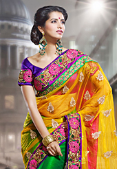 Exquisite combination of color, fabric can be seen here. This yellow and green net saree have beautiful embroidery patch work which is embellished with resham, zari and stone work. Fabulous designed embroidery gives you an ethnic look and increasing your beauty. Contrasting purple blouse is available. Slight Color variations are possible due to differing screen and photograph resolutions.