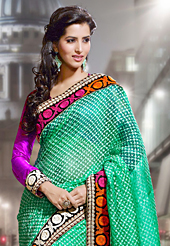 Style and trend will be at the peak of your beauty when you adorn this saree. This sea green jacquard silk saree have beautiful embroidery patch work which is embellished with resham work. Fabulous designed embroidery gives you an ethnic look and increasing your beauty. Contrasting magenta blouse is available. Slight Color variations are possible due to differing screen and photograph resolutions.