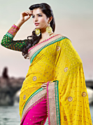 Try out this year top trend, glowing, bold and natural collection. This yellow and pink georgette saree have beautiful embroidery patch work which is embellished with resham, zari, sequins, stone and lace work. Fabulous designed embroidery gives you an ethnic look and increasing your beauty. Contrasting green blouse is available. Slight Color variations are possible due to differing screen and photograph resolutions.