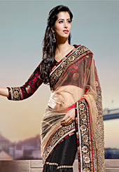 Ultimate collection of embroidery sarees with fabulous style. This fawn and black net saree have beautiful embroidery patch work which is embellished with zari, sequins and beads work. Fabulous designed embroidery gives you an ethnic look and increasing your beauty. Matching black and maroon blouse is available. Slight Color variations are possible due to differing screen and photograph resolutions.