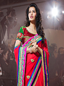 Welcome to the new era of Indian fashion wear. This red georgette saree have beautiful embroidery patch work which is embellished with resham, zari, stone and lace work. Fabulous designed embroidery gives you an ethnic look and increasing your beauty. Matching blouse is available. Slight Color variations are possible due to differing screen and photograph resolutions.
