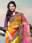 Let your personality articulate for you with this amazing embroidered saree. This yellow and pink net saree have beautiful embroidery patch work which is embellished with resham, zari and stone work. Fabulous designed embroidery gives you an ethnic look and increasing your beauty. Contrasting purple blouse is available. Slight Color variations are possible due to differing screen and photograph resolutions.