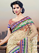 The most beautiful refinements for style and tradition. This cream net saree have beautiful embroidery patch work which is embellished with resham, zari and stone work. Fabulous designed embroidery gives you an ethnic look and increasing your beauty. Contrasting red blouse is available. Slight Color variations are possible due to differing screen and photograph resolutions.