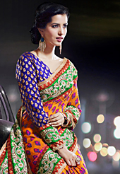 An occasion wear perfect is ready to rock you. This shaded orange and pink georgette saree have beautiful embroidery patch work which is embellished with resham, zari and stone work. Fabulous designed embroidery gives you an ethnic look and increasing your beauty. Contrasting blue blouse is available. Slight Color variations are possible due to differing screen and photograph resolutions.