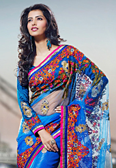 It is color this season and bright shaded suits are really something that is totally in vogue. This blue net saree have beautiful embroidery patch work which is embellished with resham, zari and stone work. Fabulous designed embroidery gives you an ethnic look and increasing your beauty. Matching blouse is available. Slight Color variations are possible due to differing screen and photograph resolutions.