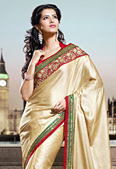 Ultimate collection of embroidery sarees with fabulous style. This beige shimmer georgette saree have beautiful embroidery patch work which is embellished with zari and sequins work. Fabulous designed embroidery gives you an ethnic look and increasing your beauty. Contrasting red blouse is available. Slight Color variations are possible due to differing screen and photograph resolutions.