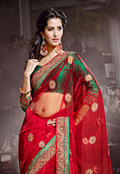 Exquisite combination of color, fabric can be seen here. This red net saree have beautiful embroidery patch work which is embellished with zari, sequins and stone work. Fabulous designed embroidery gives you an ethnic look and increasing your beauty. Contrasting green blouse is available. Slight Color variations are possible due to differing screen and photograph resolutions.