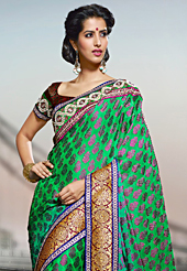 Style and trend will be at the peak of your beauty when you adorn this saree. This shaded green viscose georgette saree have beautiful embroidery patch work which is embellished with resham, zari and stone work. Fabulous designed embroidery gives you an ethnic look and increasing your beauty. Contrasting dark red blouse is available. Slight Color variations are possible due to differing screen and photograph resolutions.