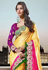 The fascinating beautiful subtly garment with lovely patterns. This yellow and pink crepe jacquard saree have beautiful embroidery patch work which is embellished with zari and beads work. Fabulous designed embroidery gives you an ethnic look and increasing your beauty. Contrasting blue and dark magenta blouse is available. Slight Color variations are possible due to differing screen and photograph resolutions.